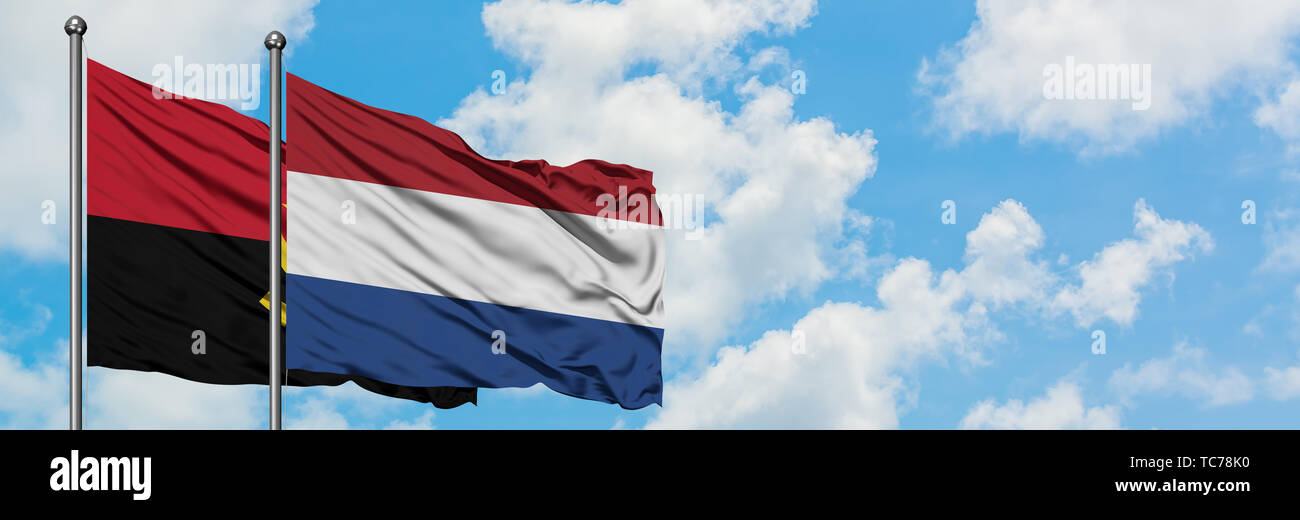 Angola and Netherlands flag waving in the wind against white cloudy blue sky together. Diplomacy concept, international relations. - Stock Image