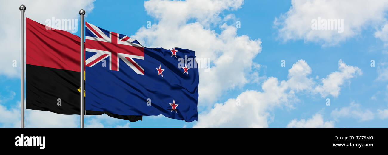 Angola and New Zealand flag waving in the wind against white cloudy blue sky together. Diplomacy concept, international relations. - Stock Image