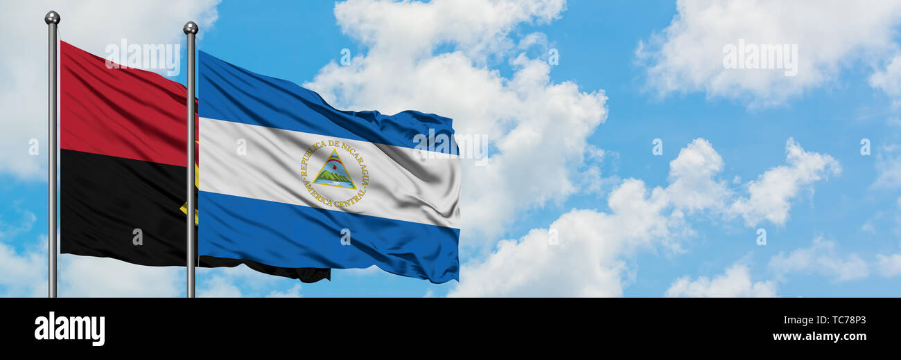 Angola and Nicaragua flag waving in the wind against white cloudy blue sky together. Diplomacy concept, international relations. - Stock Image
