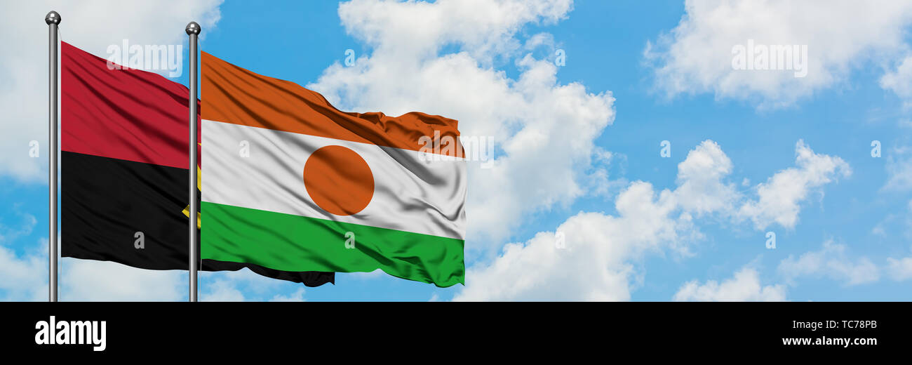 Angola and Niger flag waving in the wind against white cloudy blue sky together. Diplomacy concept, international relations. - Stock Image