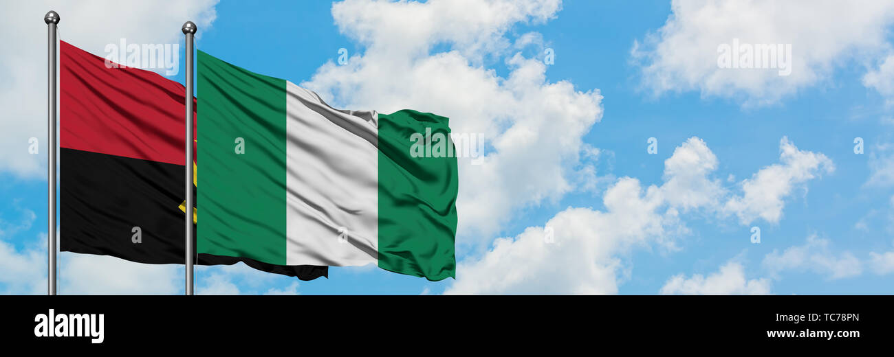 Angola and Nigeria flag waving in the wind against white cloudy blue sky together. Diplomacy concept, international relations. - Stock Image