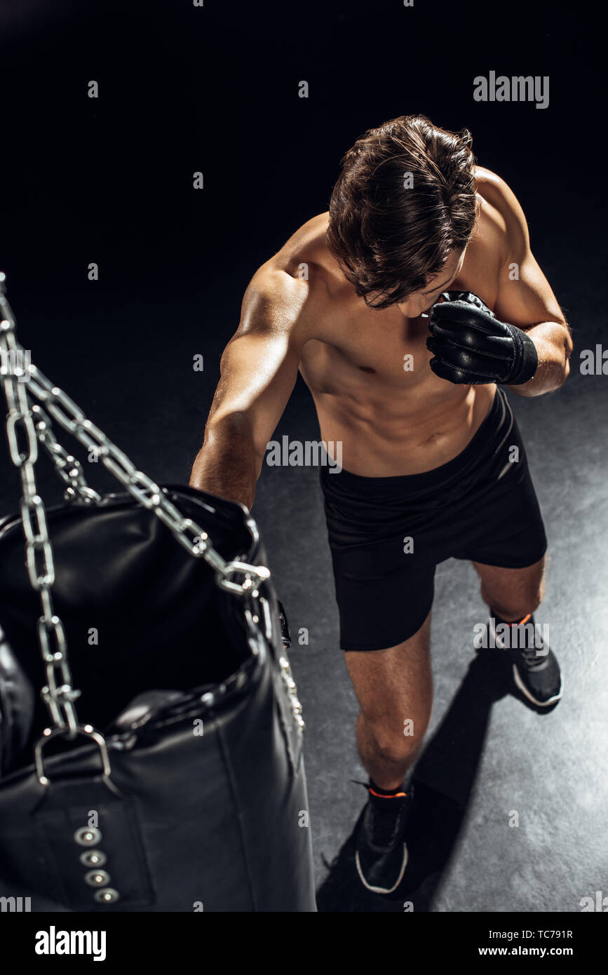 High angle view of boxer training with punching bag - Stock Image