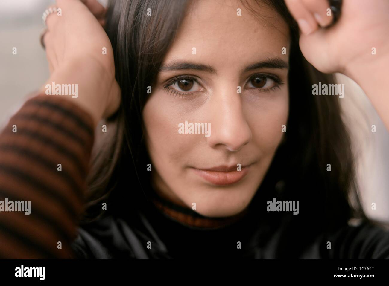 intimate close-up portrait of fashionable woman, sensitive character, in Munich, Germany - Stock Image