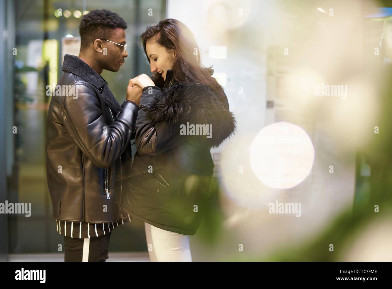 couple holding hands, in Munich, Germany Stock Photo
