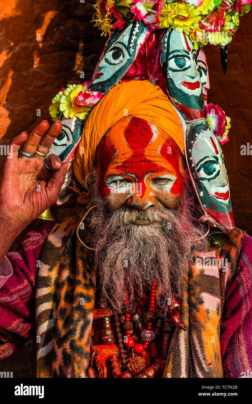A sadhu (Holy man) at the Pashupatinath Temple, a Hindu temple along the Bagmati River in Kathmandu, Nepal. The Bagmati is equally as sacred to - Stock Image