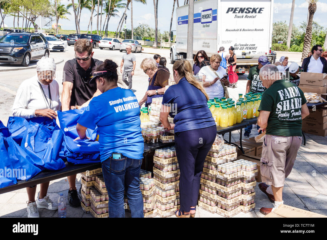 Miami Beach Florida North Beach Ocean Terrace Farm Share food giveaway free distribution needy low income volunteer man woman Hispanic Black Stock Photo