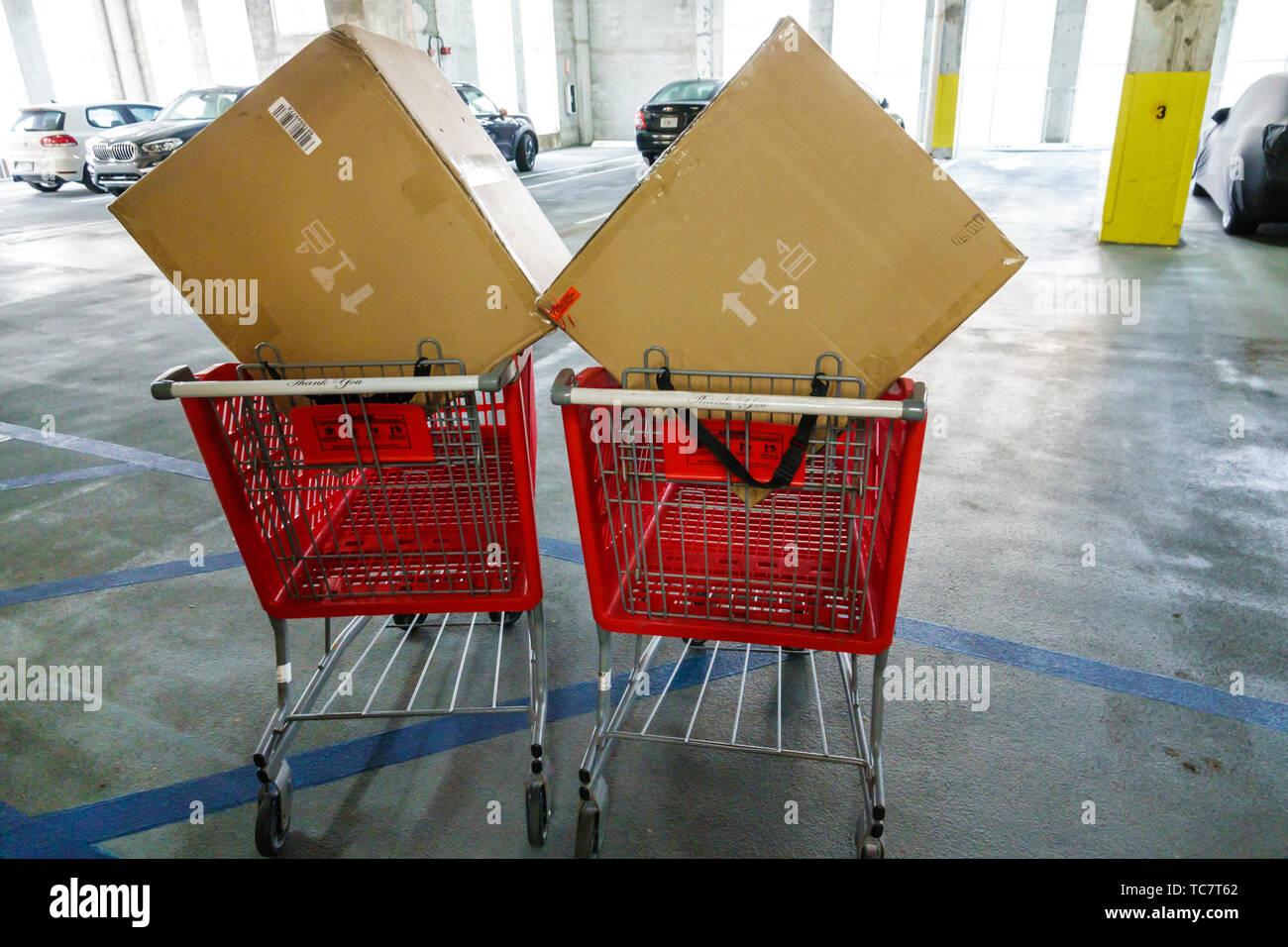 Miami Beach Florida parking garage large box boxes shopping cart carts trolley trolleys - Stock Image