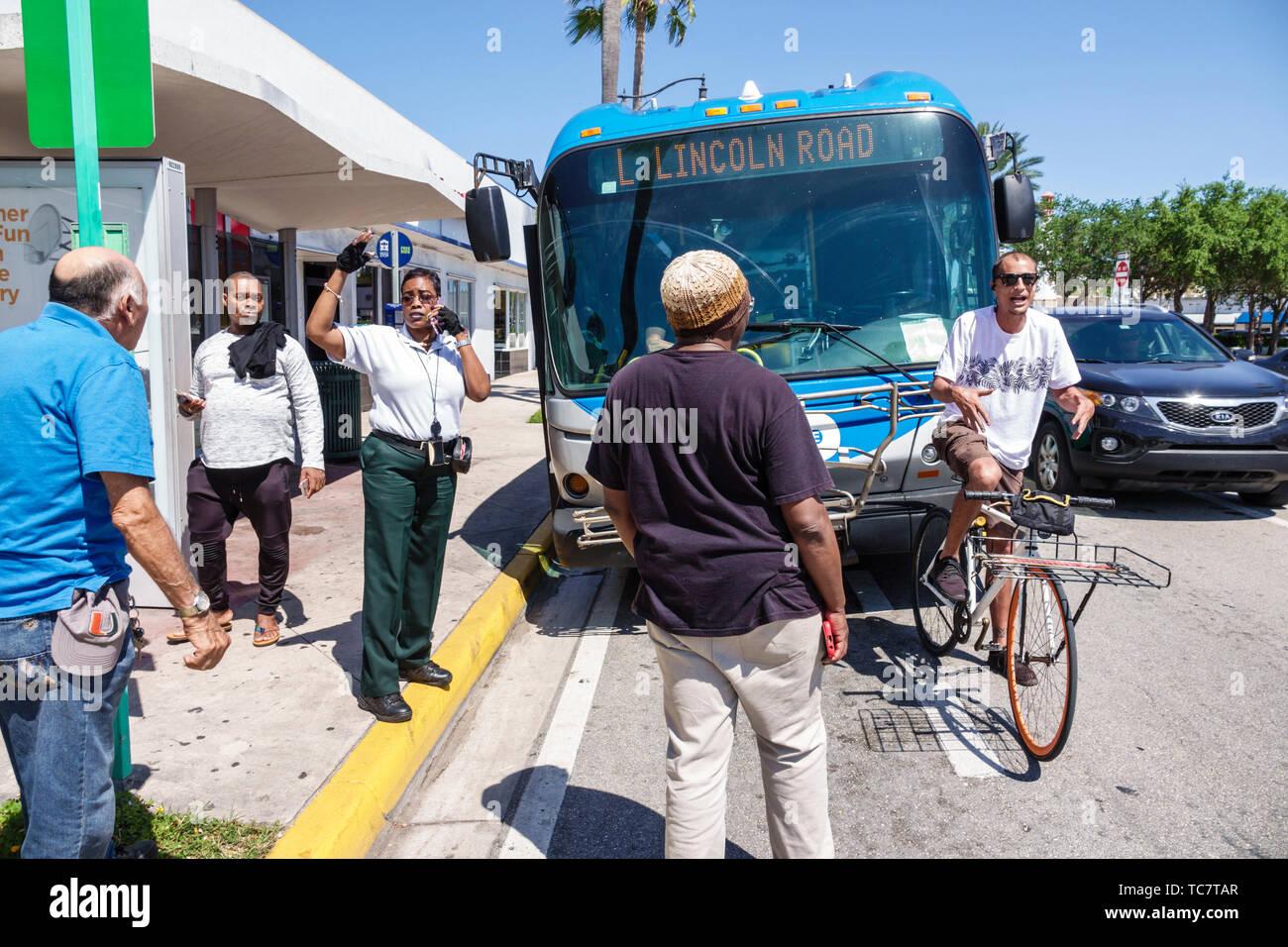 Miami Beach Florida North Beach Miami-Dade Metrobus bus public transportation disruption dispute confrontation taking law into own hands Hispanic man Stock Photo