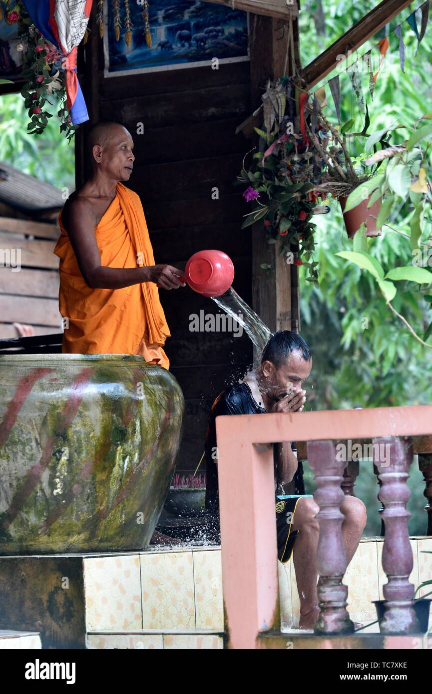Buddhist monk water blessing man,Siem Reap,Cambodia,South east Asia. Stock Photo