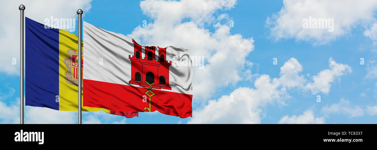 Andorra and Gibraltar flag waving in the wind against white cloudy blue sky together. Diplomacy concept, international relations. Stock Photo