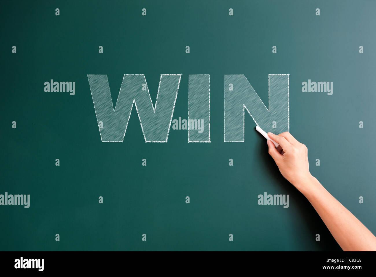 win written on blackboard - Stock Image