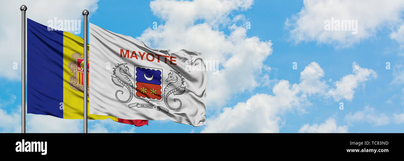 Andorra and Mayotte flag waving in the wind against white cloudy blue sky together. Diplomacy concept, international relations. Stock Photo