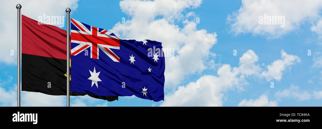 Angola and Australia flag waving in the wind against white cloudy blue sky together. Diplomacy concept, international relations. - Stock Image