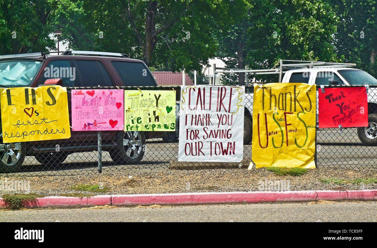 Signs on the perimeter of the Shasta County Fair Grounds in Anderson, California thanking firefighters and others working to contain the Carr Fire in - Stock Image