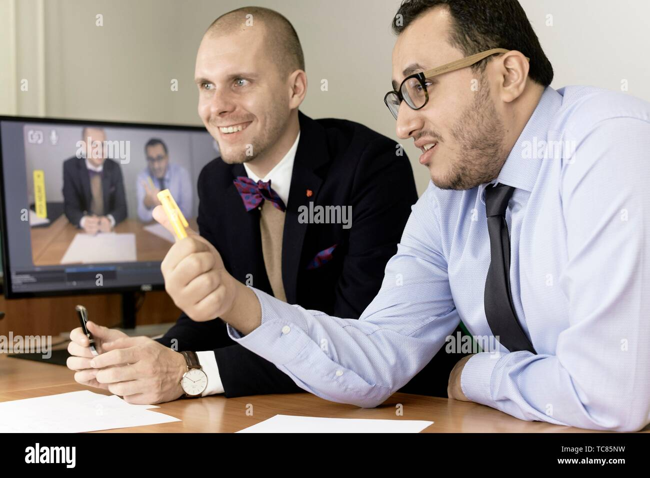 business men at conference, lawyers consulting at online live stream, in Cottbus, Brandenburg, Germany - Stock Image