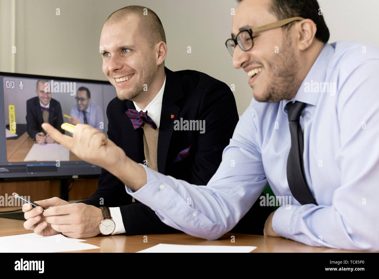 happy business men at conference, lawyers consulting at online live stream, in Cottbus, Brandenburg, Germany - Stock Image