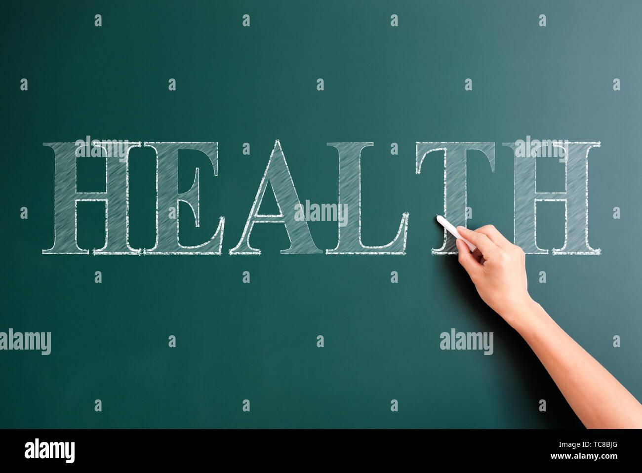 Health written on blackboard - Stock Image
