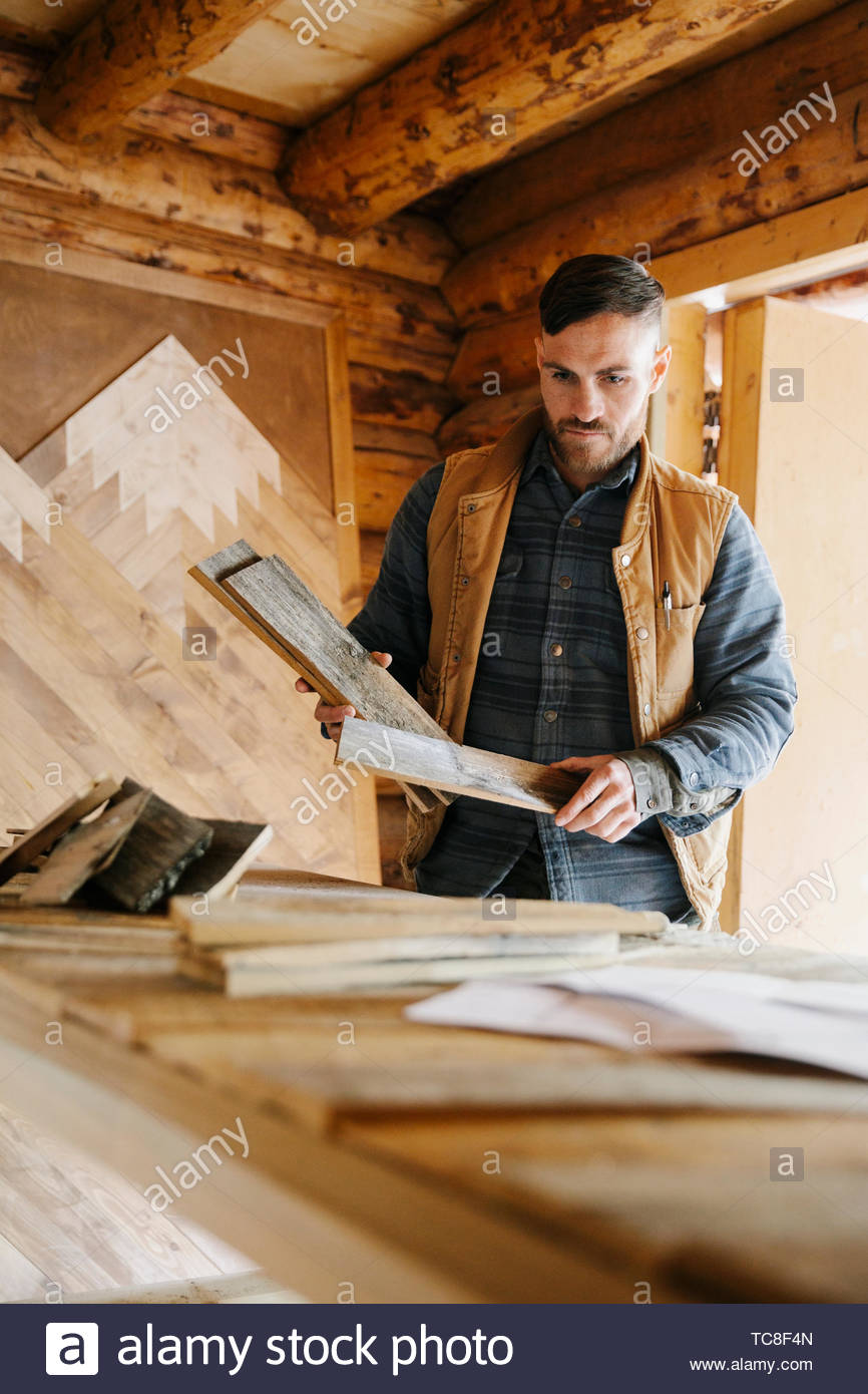 Male carpenter woodworking in workshop - Stock Image