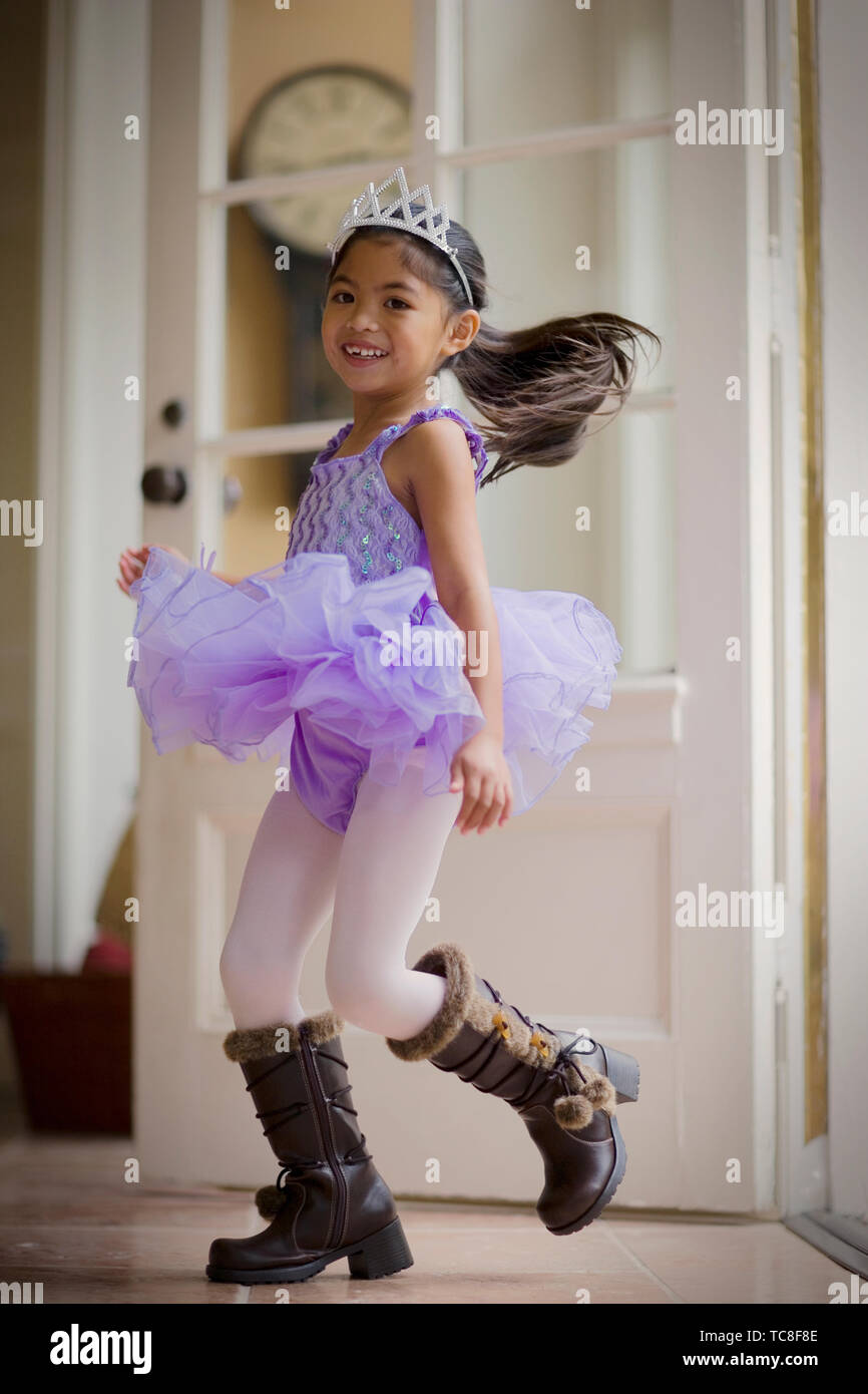 078fc8ec4 Young girl dancing while wearing brown leather boots and a tutu. - Stock  Image