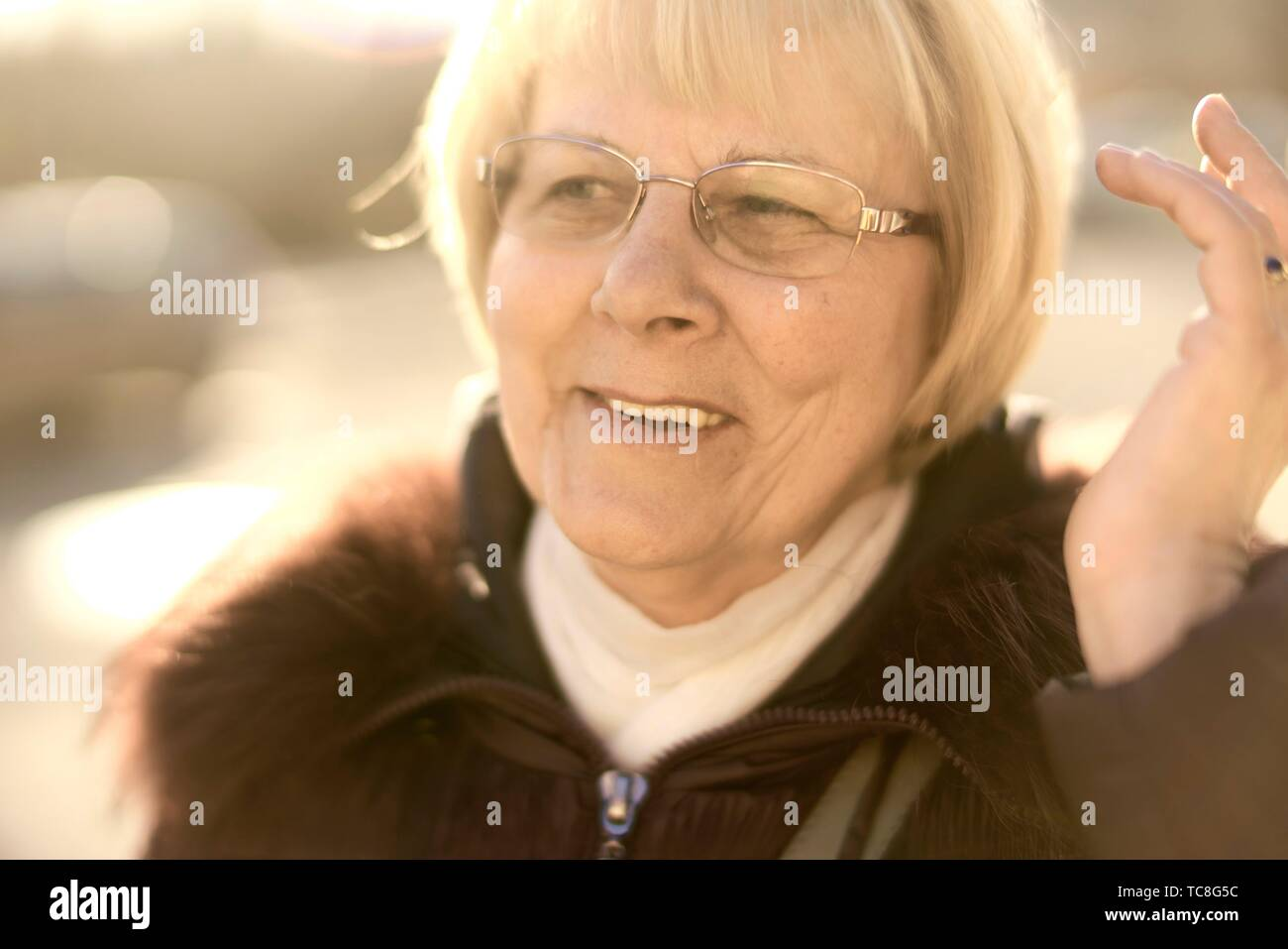 upbeat senior woman searching for idea, positiveness, in Cottbus, Brandenburg, Germany. - Stock Image