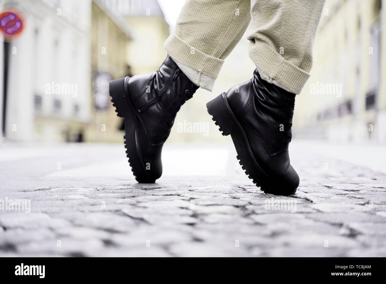 trendy black shoes tiptoe of fashionable woman at street during fashion week, in Paris, France. - Stock Image
