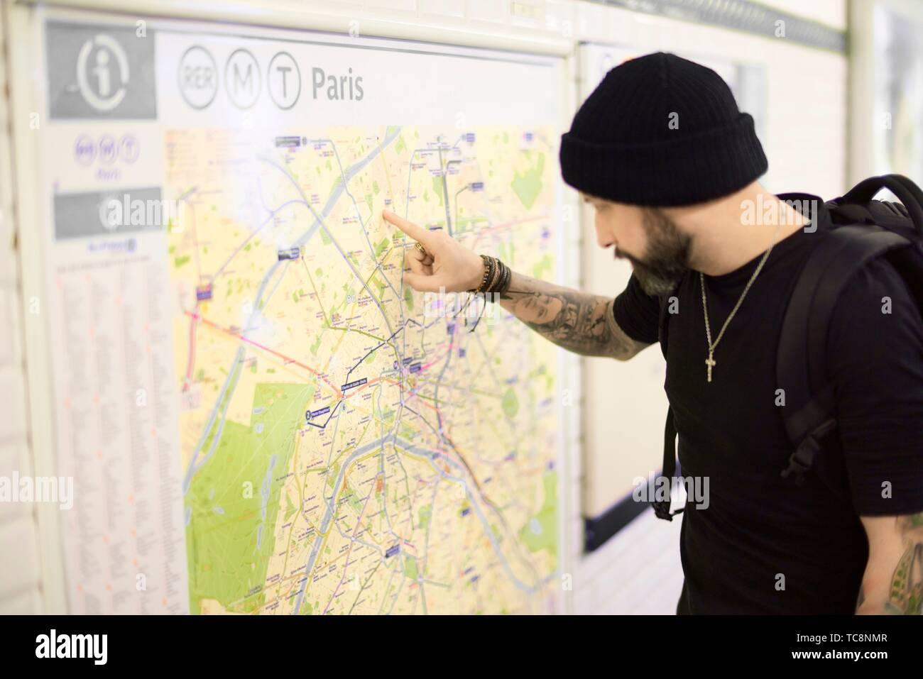 Subway Map Baseball.Man Looking At Map In Subway Station Paris France Stock Photo
