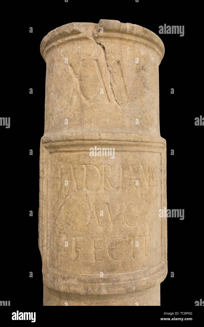 Seville, Spain - Apr. 17, 2019: Roman milestone or Miliarium. Hadrian rule at Seville Archeological Museum. - Stock Image