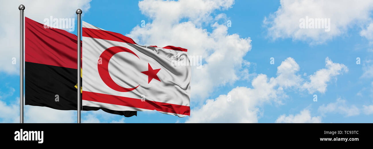 Angola and Northern Cyprus flag waving in the wind against white cloudy blue sky together. Diplomacy concept, international relations. - Stock Image