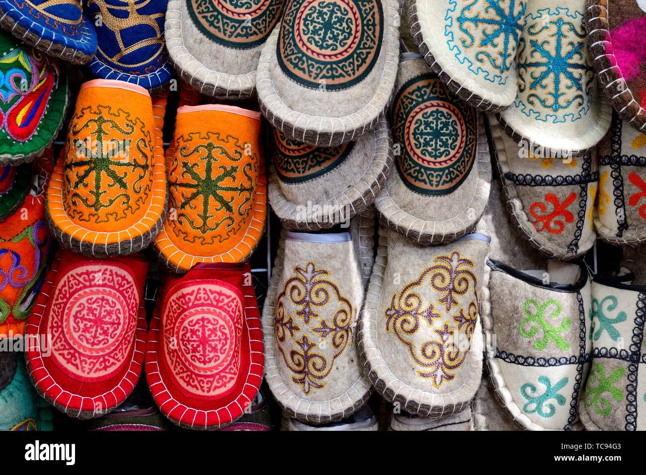 Customary shoes in Osh Bazaar of Bishkek, Kyrgyzstan - Stock Image