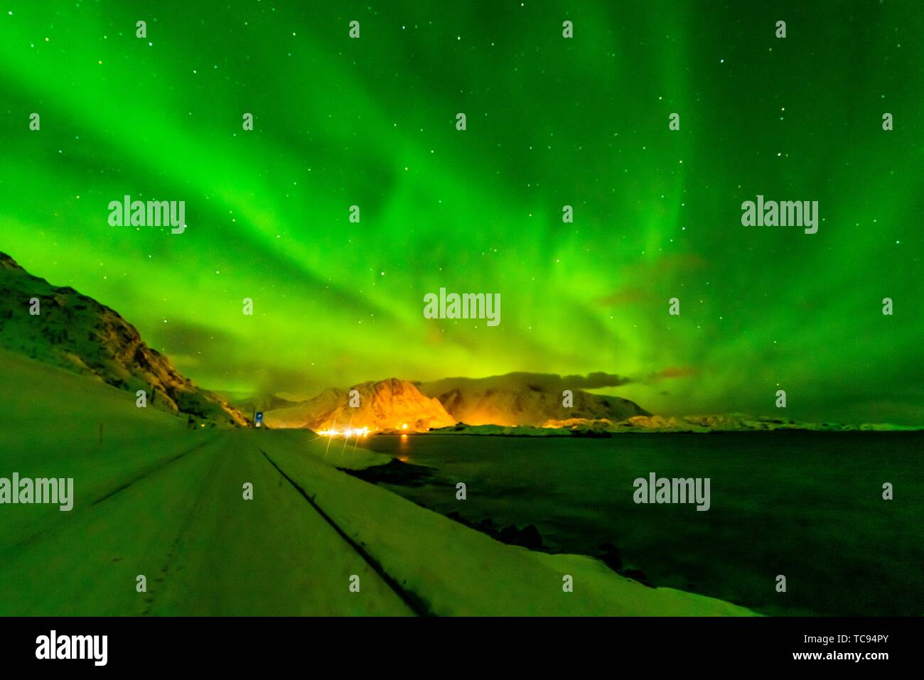 Northern Lights (Aurora Borealis) seen from along the E10 near Reine, Moskenoesoya Island, Lofoten Islands, Arctic, Northern Norway. - Stock Image