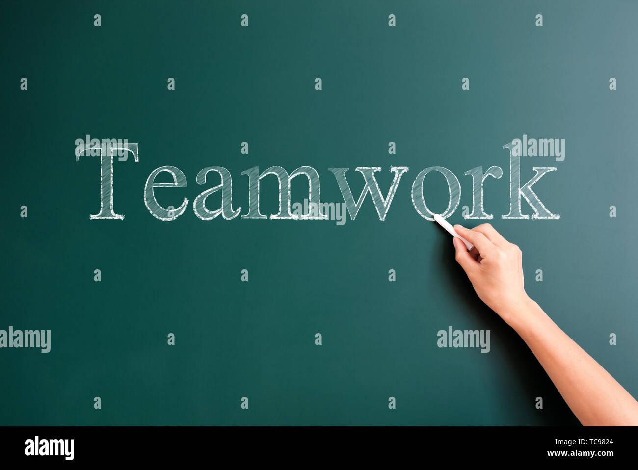 teamwork written on blackboard - Stock Image