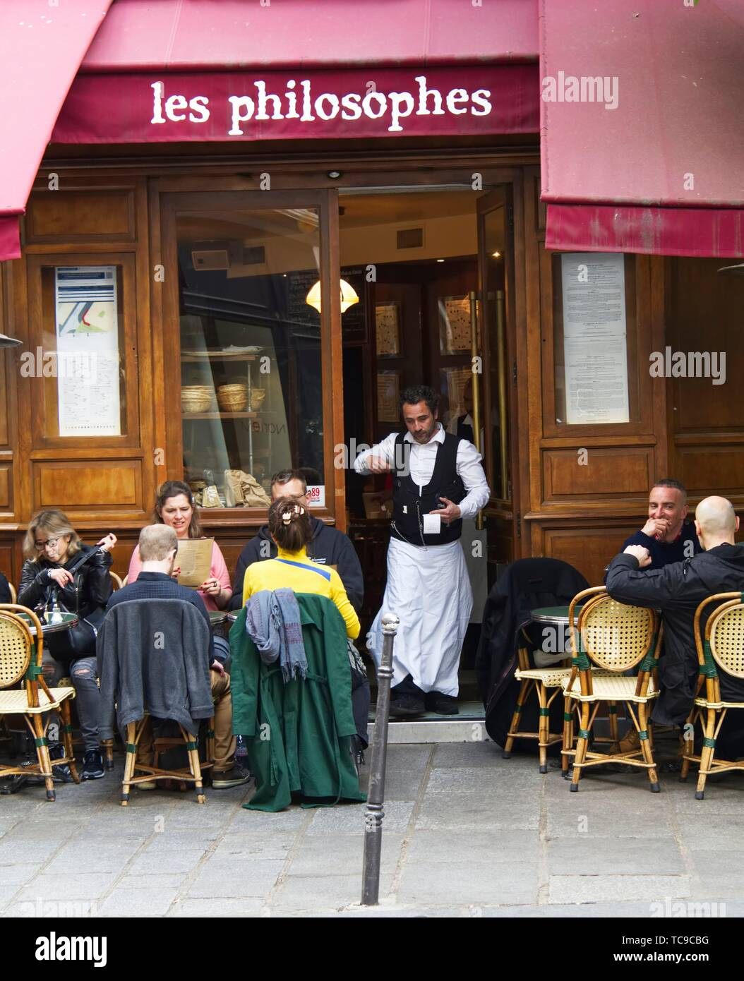 waiter in door of Cafe les Philosophes, Marais District, Paris, France. - Stock Image