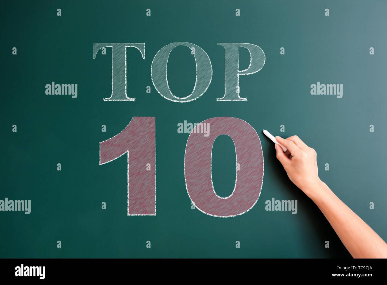 top 10 written on blackboard - Stock Image