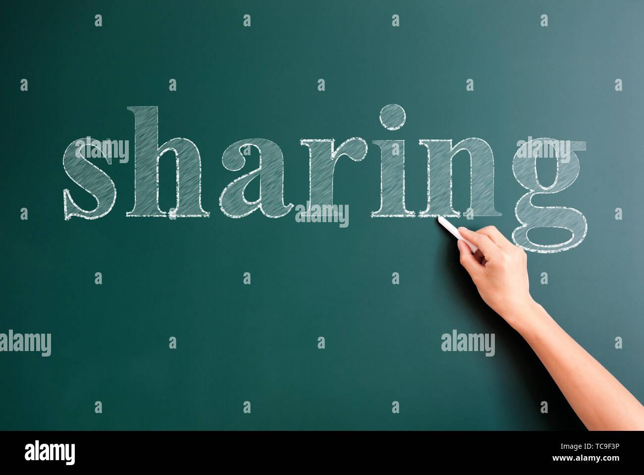 sharing written on blackboard - Stock Image