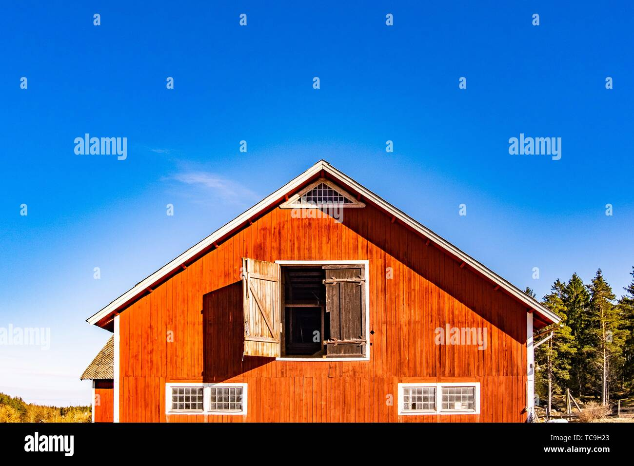 Traditional red barn in Sweden. - Stock Image