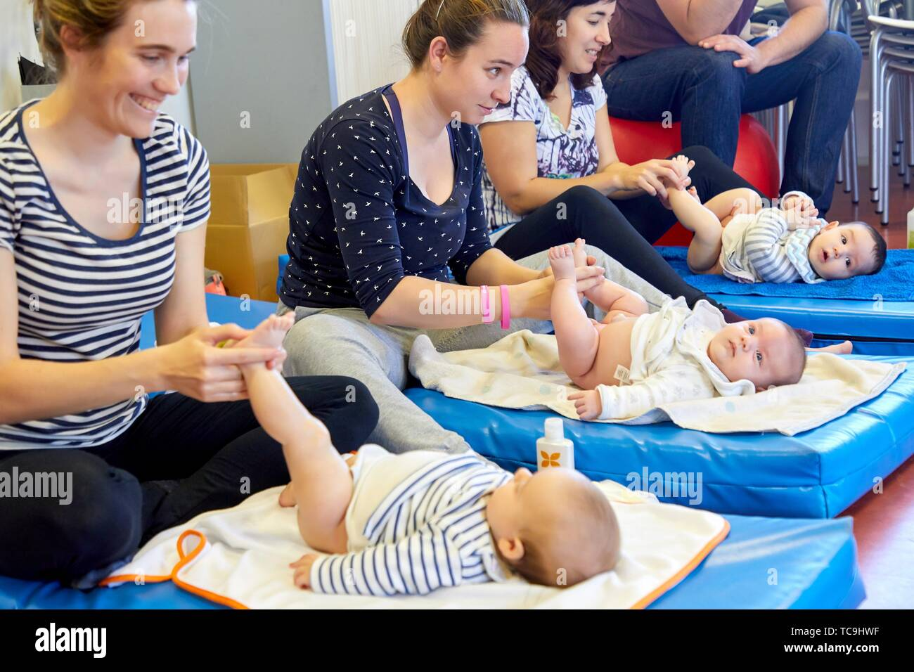 Matron instructing mothers in massage to babies, Health Center, Zarautz, Gipuzkoa, Basque Country, Spain - Stock Image