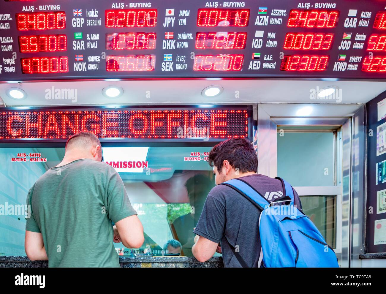 Unidentified people change currency at money changer shop in Istanbul, Turkey. 26 May 2018. - Stock Image
