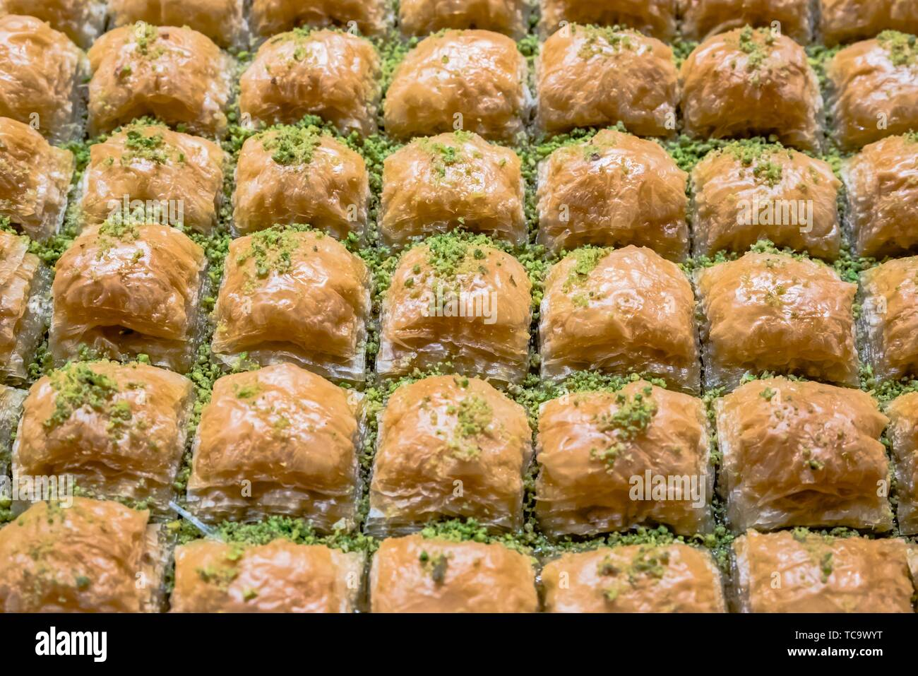 Top Close detailed view of traditional delicious Turkish dessert named baklava with grinded pistachio over. - Stock Image