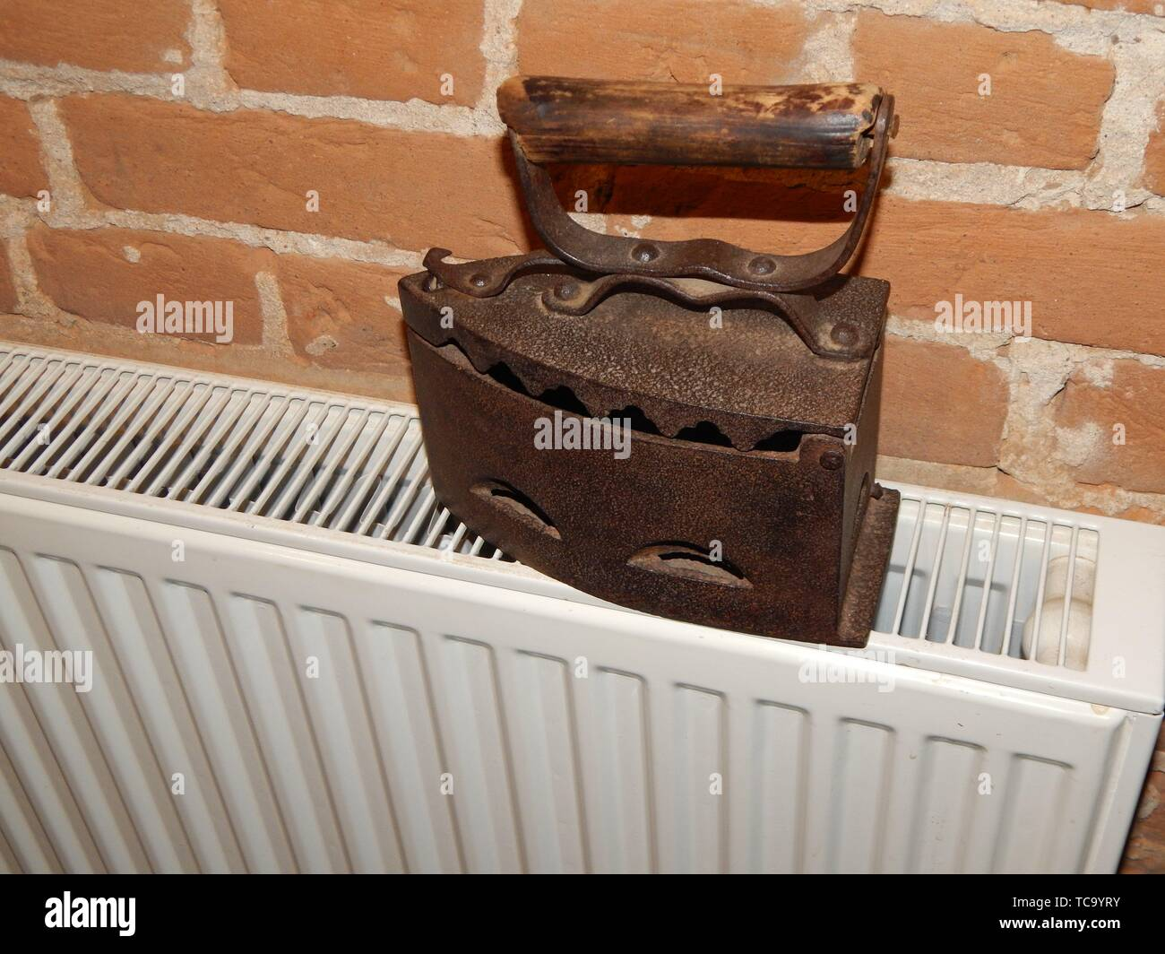 Antique iron in the interior for ironing clothes. - Stock Image
