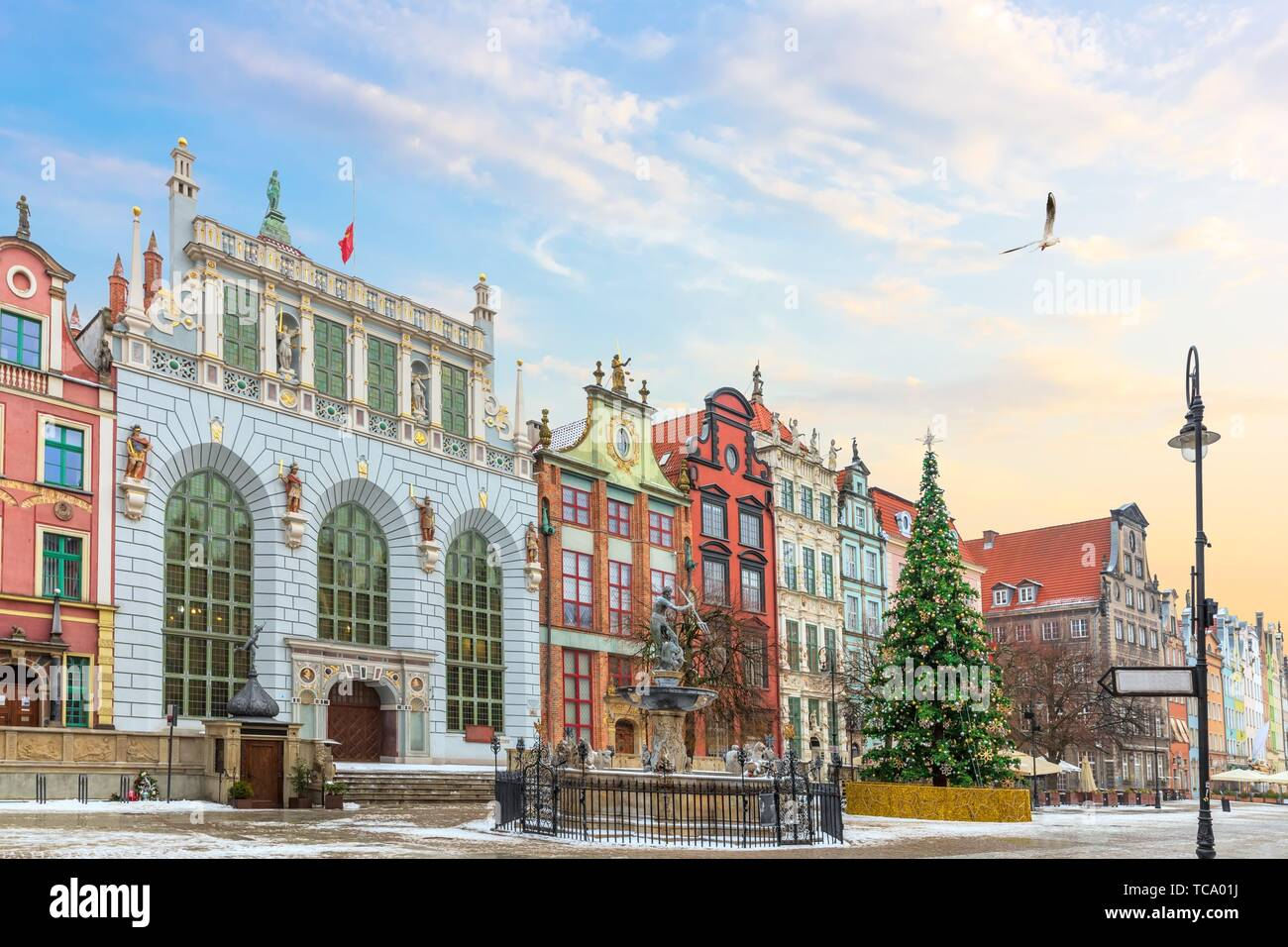 View on the Neptune's Fountain and the the Artus Court facade in Long Market, Gdansk, Poland, no people. Stock Photo