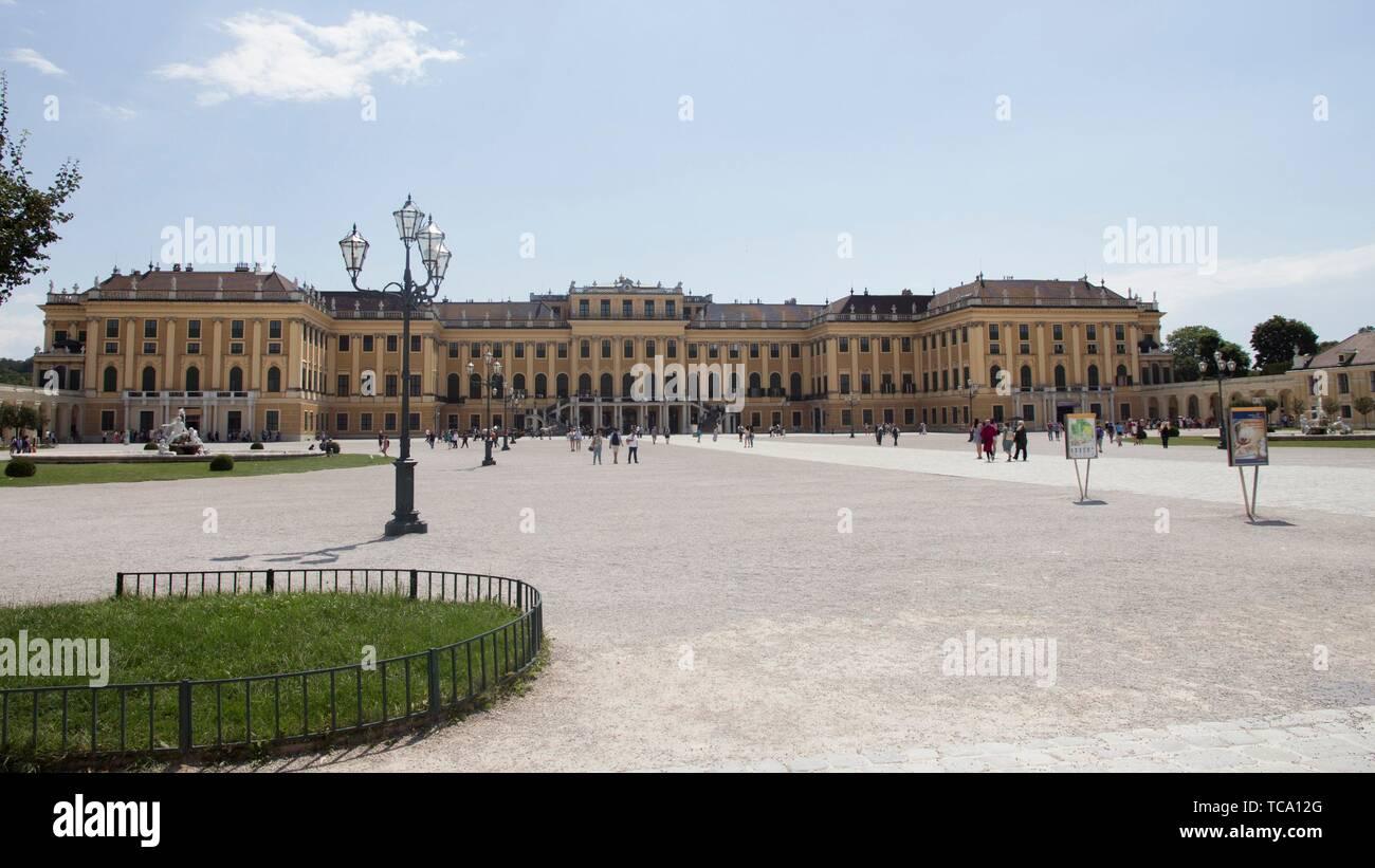 "Vienna, Austria - July 06 2018: ''Schonbrunn'' palace (Schloss Schönbrunn) and the park with a blue sky and cloudsâ. "" Stock Editorial Photo. - Stock Image"