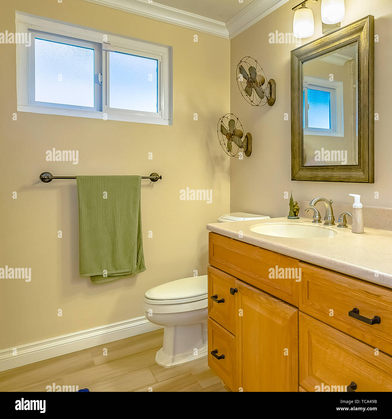 Square Double Vanity With Wooden Cabinets Inside A Bathroom With Small Window Stock Photo Alamy
