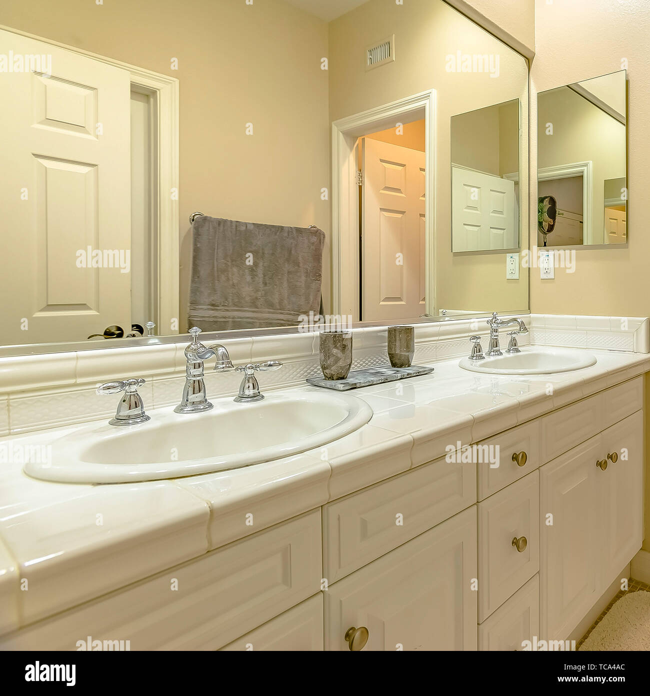 Frame Square Interior Of A Small Bathroom With A Double Sink Vanity Area And Wood Cabinets Stock Photo Alamy