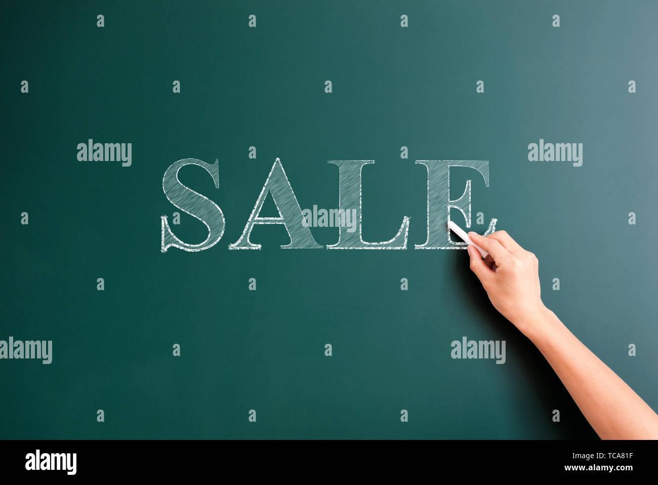 sale written on blackboard - Stock Image