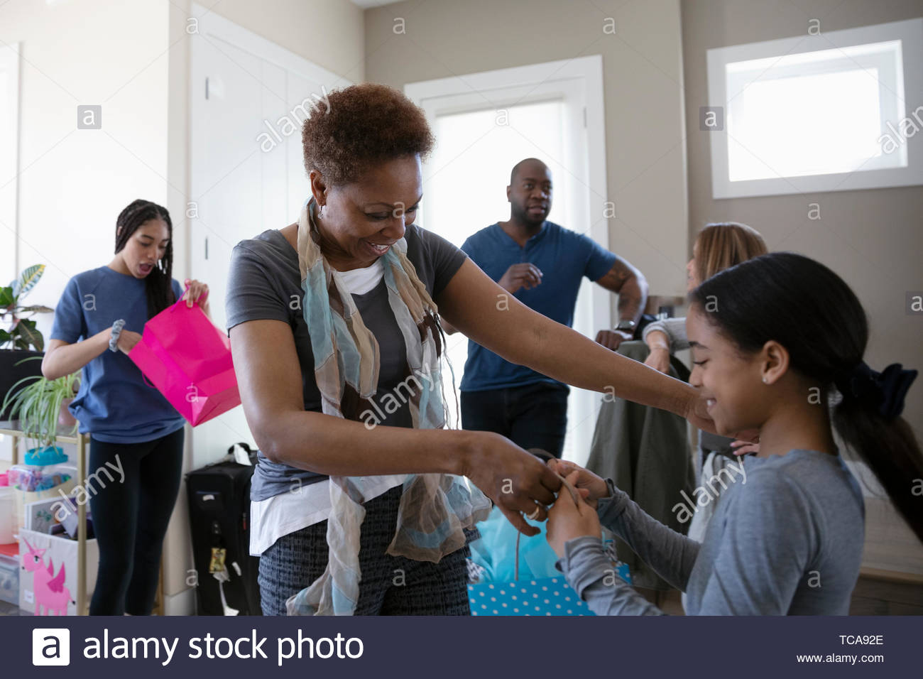Grandmother giving gift to granddaughter - Stock Image