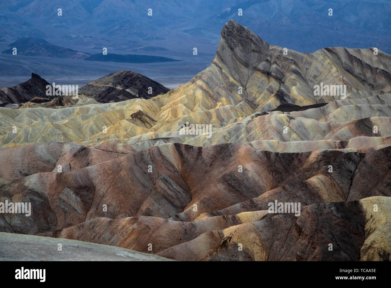 The eroded sandstone rock formations of Zabriske Point at Death Valley National Park, California. Stock Photo