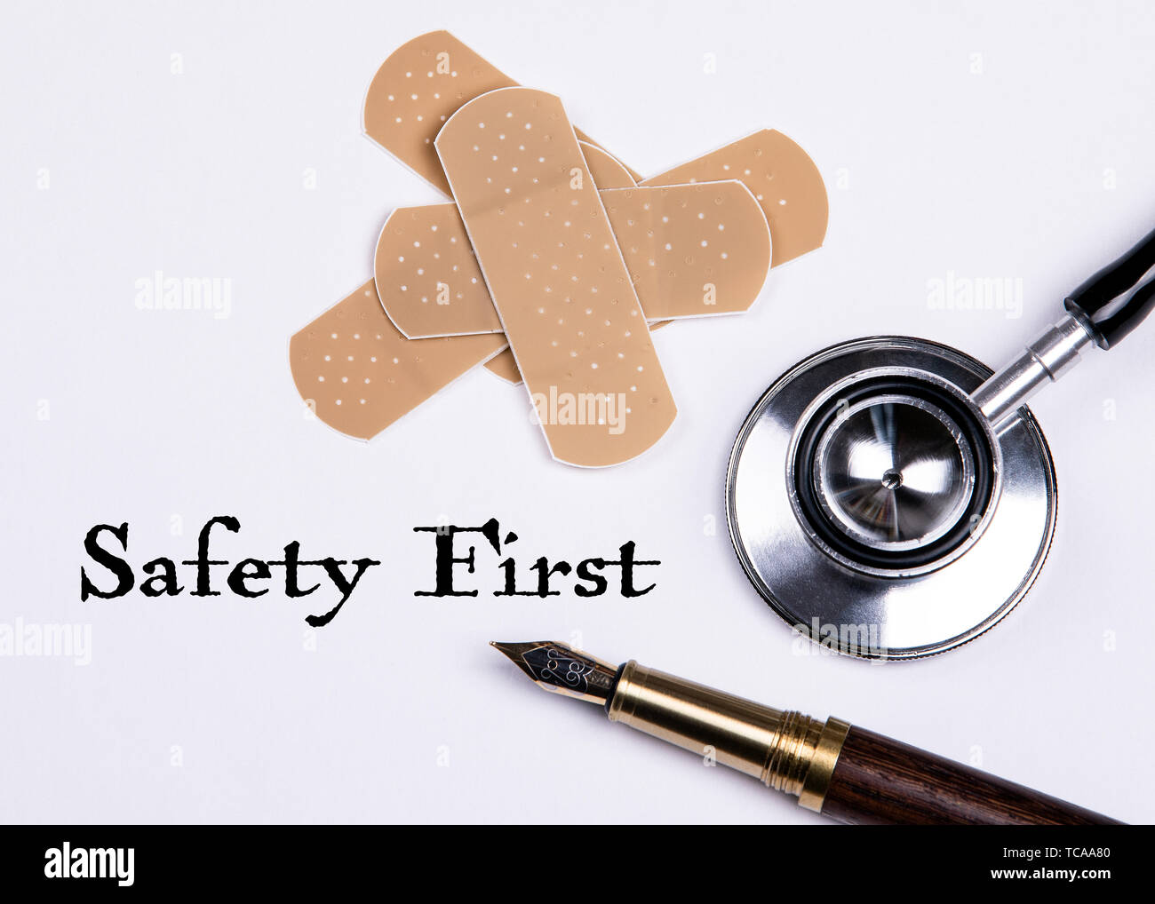 Safety First. Set of adhesive plasters and stethoscope on white background - Stock Image