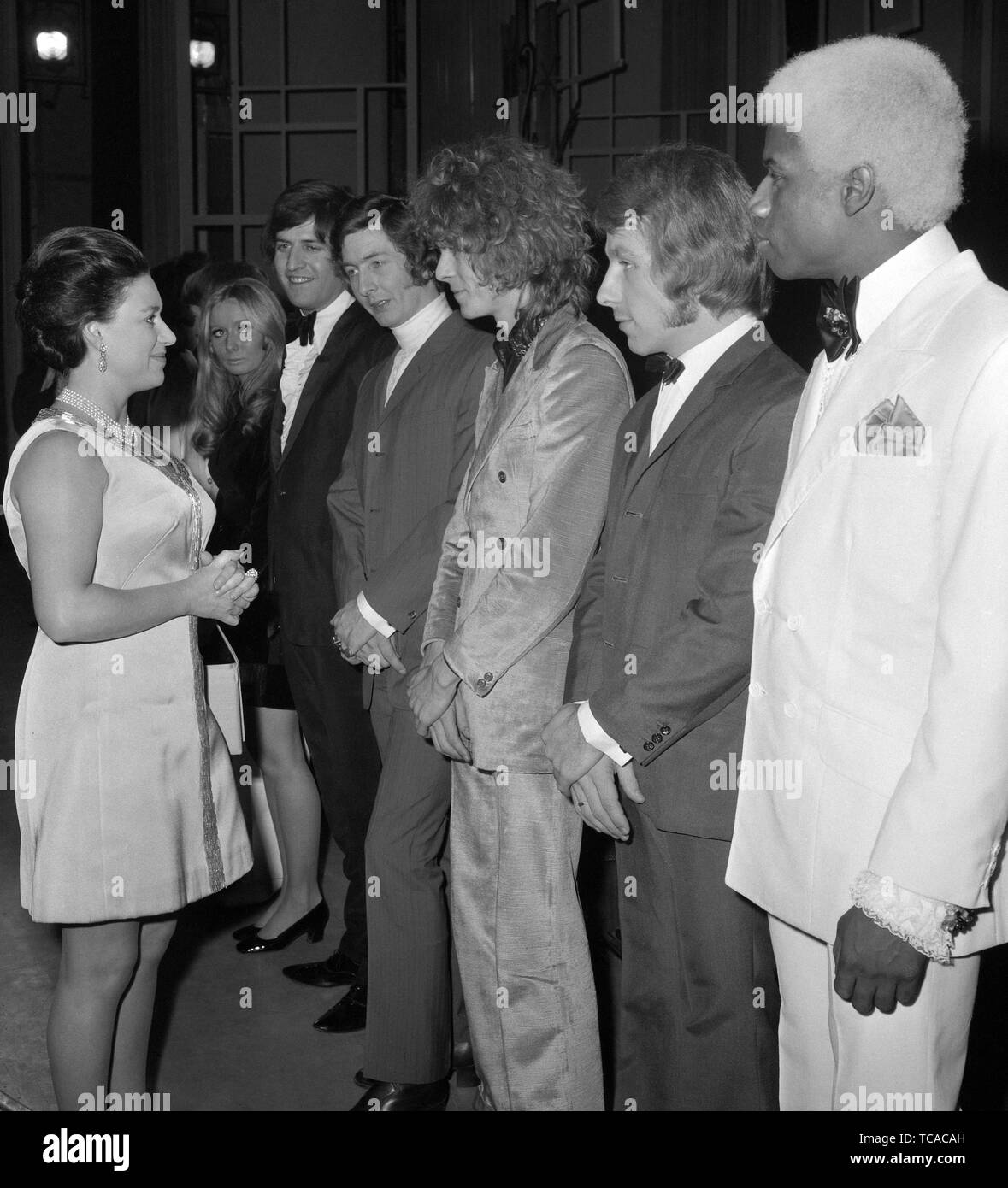 Princess Margaret, President of the Invalid Children's Aid Association (ICAA), meets The Equals pop group at the London Palladium after they appeared in this year's Save Rave Charity Show, aiding the ICAA. Clodagh Rogers, the singer (background) replaced The Marmalade, who had to withdraw. *David Bowie in centre Stock Photo