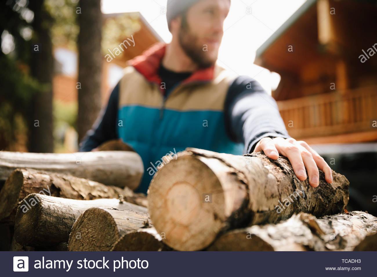 Man stacking firewood - Stock Image