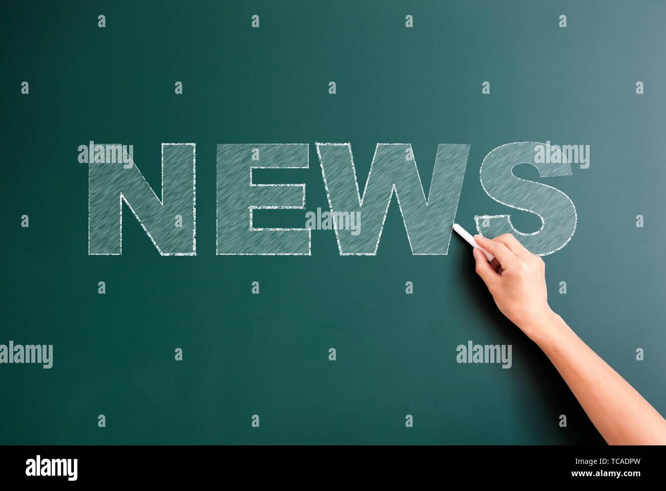 news written on blackboard - Stock Image